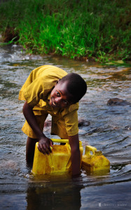 charity: water september campaign - boy in Rwanda