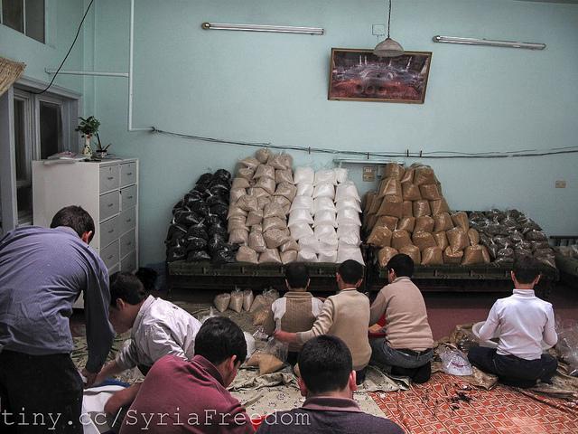men preparing aid syria