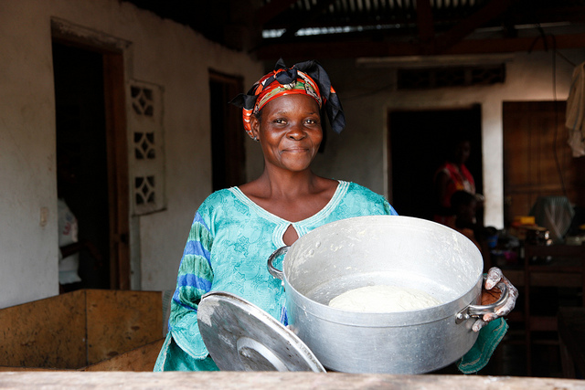 A woman mixing dough to make bread in the town of Masi Manimba, DRC