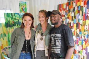 Lanee Lee Neil and Lindsay Taub with painter Fred Abuga in his studio at Kuona Trust, Nairobi