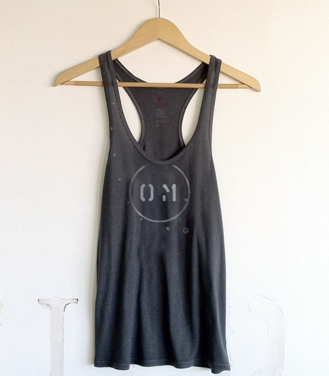 Manduka Om Tank e1363568578899 Namaste: 5 Cool Items For Yogis That Give Back