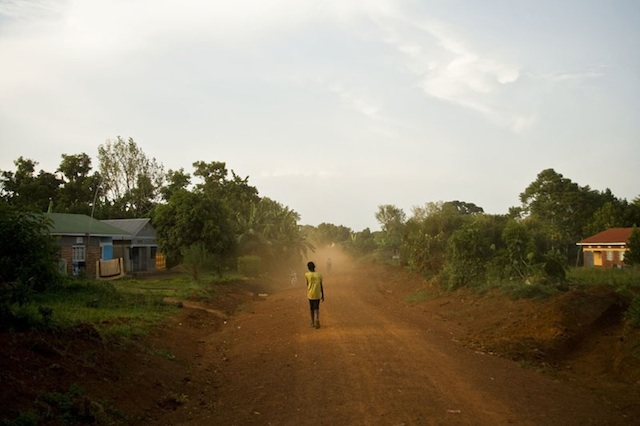 Boy Walks Alone on Village Road