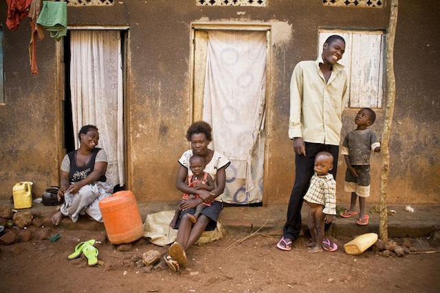 Ugandan Family in Front of Village Home